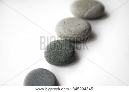 sea stones isolated on white               rounded pebble