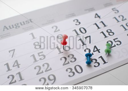 Monthly Calendar Grid On Table With Office Supplies