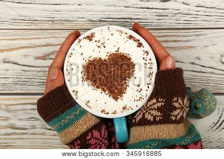 Close Up Two Woman Hands Hold And Hug Big Full Cup Of Latte Cappuccino Coffee With Heart Shaped Choc