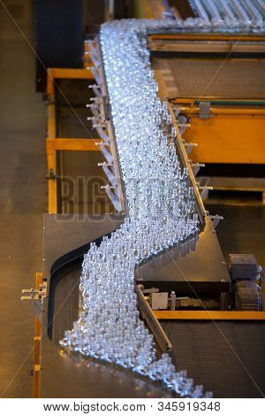Glassworks. Glass Industry. A Lot Of Glass Bottles On The Conveyor.