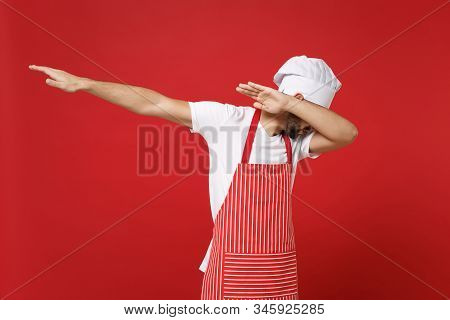 Young Bearded Male Chef Cook Baker Man In Striped Apron White T-shirt Toque Chefs Hat Posing Isolate