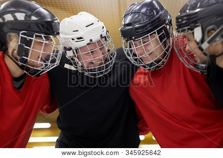 Portrait Of Female Hockey Team Huddling Happily Before Sports Match, Copy Space