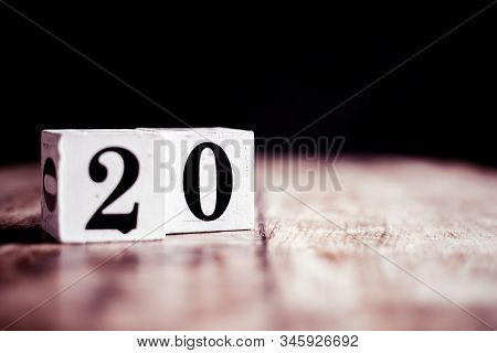 Number 20 Isolated On Dark Background- 3d Number Twenty Isolated On Vintage Wooden Table