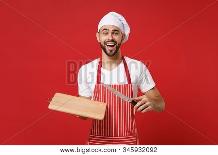 Excited Young Bearded Male Chef Cook Or Baker Man In Striped Apron White T-shirt Toque Chefs Hat Pos