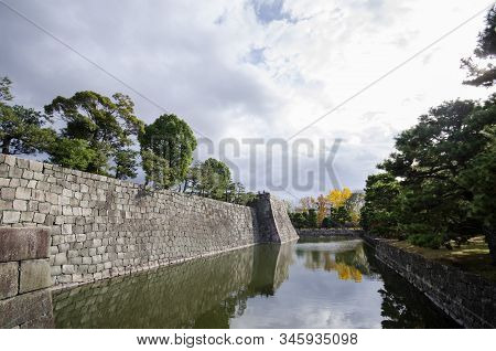 Fortification Of Nijojo Castle In Kyoto Japan During Autumn Season. Nijo Castle Consists Of Two Conc
