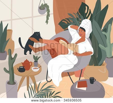 Happy Cute Girl With Towel On Head And In Bathrobe, Having Breakfast In Morning After Bathing, Read
