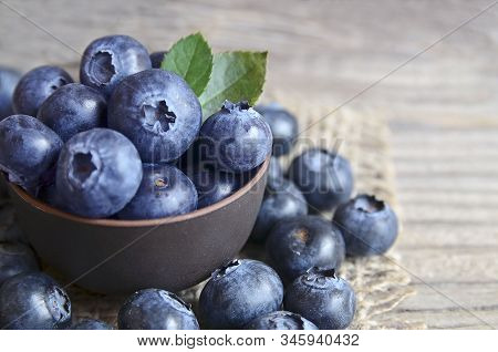 Freshly Picked Organic Blueberries In A Brown Bowl On Wooden Background.blueberry. Bilberries.health