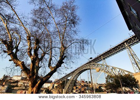 Porto, Portugal- January 6, 2020: Beautiful And Colossal Iron Bridge Called Dom Luis I Over The Wate