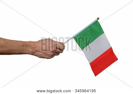 Man Is Holding Italian Flag In Hand. Isolated On White Background.
