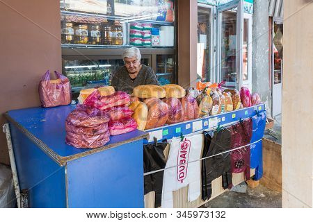 Kutaisi, Georgia, October 13, 2019 : A Salesman Sits Near His Bakery Counter In A Market In The Old