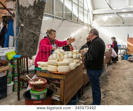 Kutaisi, Georgia, October 13, 2019 : A Dairy Seller Trades With A Buyer Near His Counter In The Mark