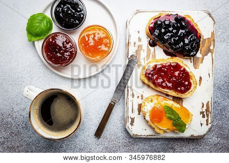 Sandwich With Various Sweet Fruit Jams And Cottage Cheese On Light Background, Top View With Copy Sp