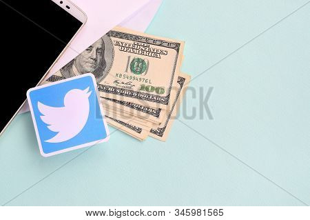 Twitter Paper Logo Lies With Envelope Full Of Dollar Bills And Smartphone