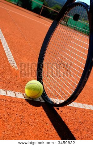 Tennis Racket And Ball On The Tennis-Court