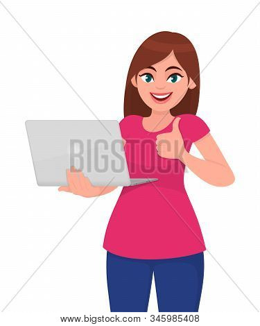 Young Woman Holding Laptop Computer And Thumbs Up Gesture. Trendy Girl Using Gadget And Showing Good