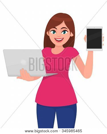 Trendy Young Woman Holding A New Laptop Computer And Showing Digital Tablet Or Pad. Stylish Girl Usi