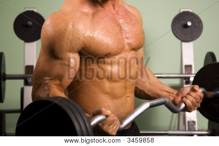 Close-Up Of An Athletic Man Lifting Weights