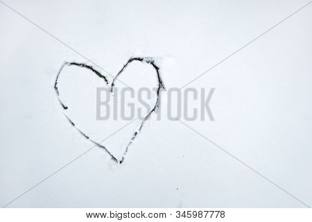 Heart Drawn By Stick On White Snow . Beautiful Winter Background For Valentines Day Or Christmas. St
