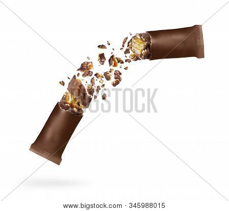 Chocolate Bar With Nuts Crushed In The Air On A White Background