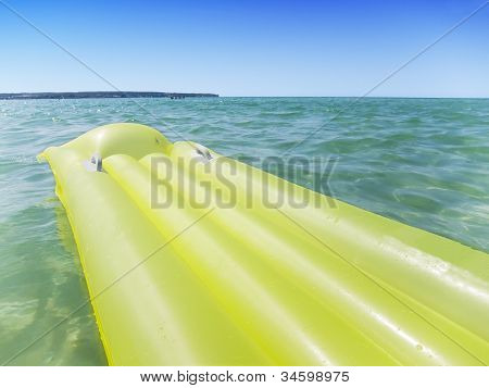 Yellow Airbed In The Sea