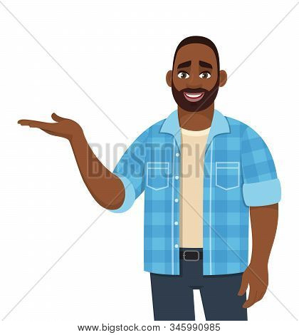 Young African American Man Presenting Hand Gesture. Stylish Person Pointing Hand To Copy Space. Male