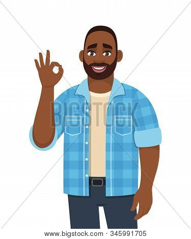 Young African Man Showing Okay, Cool Gesture Sign With Fingers. Trendy Happy Looking Black Person Ma