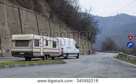 Traveling By Auto Home. Camper Van On The Road. Camper Trailer. Romania, Transfagarasan. January, 11