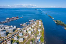 Aerial View Large Port Oil Loading Terminal With Large Storage Tanks. Delivery Of Bulk Cargo And The