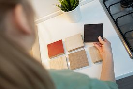 Woman Choosing Kitchen Furniture Mdf Material Texture From Samples