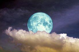 Full Oak Moon On Night Sky And White Cloud