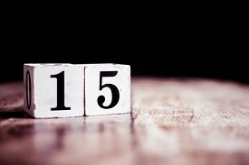 Number 15 Isolated On Dark Background- 3d Number Fifteen Isolated On Vintage Wooden Table