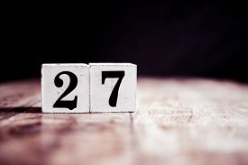 Number 27 Isolated On Dark Background- 3d Number Twenty Seven Isolated On Vintage Wooden Table