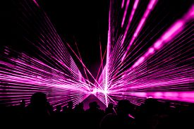 Pink Laser Show Nightlife Club Stage With Party People Crowd. Luxury Entertainment With Audience Sil