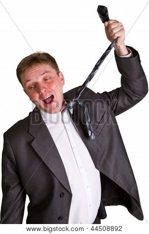 Mid-adult Man Pulling Necktie Out To Choke Himself While Making Facial Expression