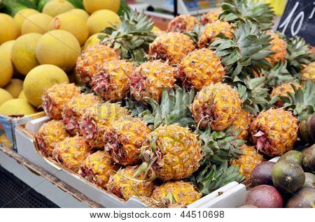 Close Up Of Fresh Pineapple On Market Stand