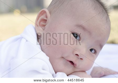 adorable baby look ahead in green area