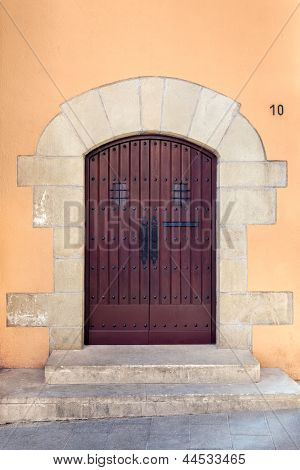 Old Door With Arch At Sarri� Quarter Of Barcelona