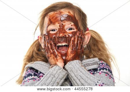 Little Girl With Chocolate Covered Face
