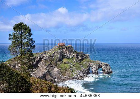 Panoramic View Of The Hermitage Of San Juan De Gaztelugatxe Located On Tiny Islet On The Coast Of Bi