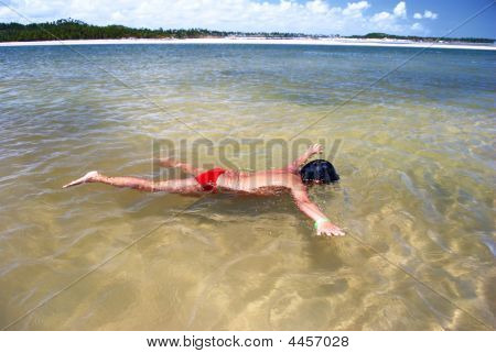 Swimming In Crystalline Clear Waters In Pernambuco Brazil