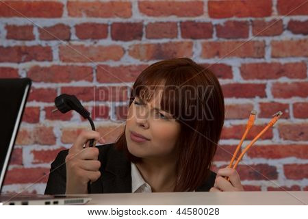 Confused Woman Installing A Laptop
