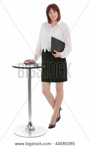 Businesswoman Standing Alongside A Small Table