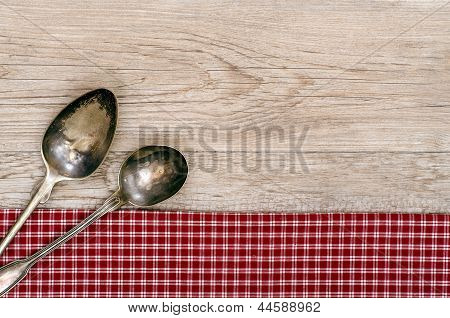Weathered Wood With Two Silver Spoons
