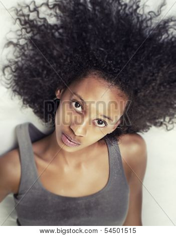 Beautiful African American young woman with curly frizz hair