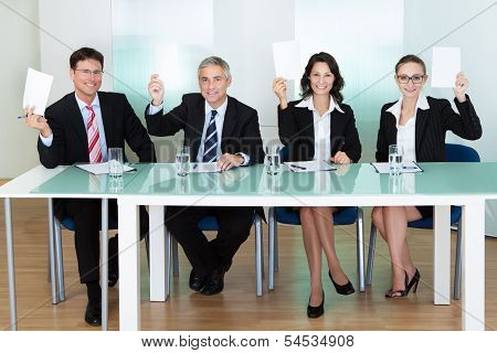 Group Of Judges Holding Up Blank Cards