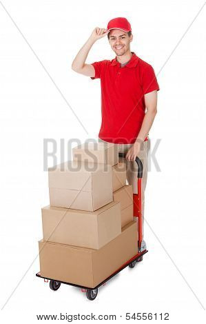 Deliveryman With A Trolley Of Boxes