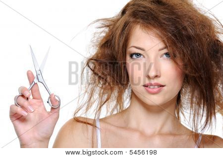 Female With Backcombing Hair And With Scissors