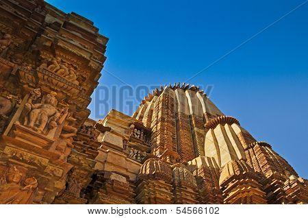 Top of Kandariya Mahadeva Temple , dedicated to Lord Shiva , Western Temples of Khajuraho , Madhya Pradesh , India - UNESCO world heritage site. Popular world tourist destination. poster