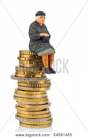 pensioner sitting on a pile of money, symbolic photo for pensions, retirement, old-age security