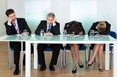 Bored panel of professional judges or corporate interviewers lounging around on a table napping as they wait for something to happen poster